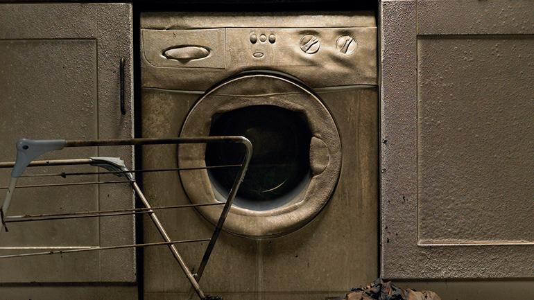 Nedbrent vaskemaskin.